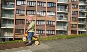 A boy playing in Whitehawk housing estate, Brighton.