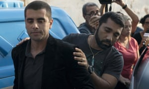 Celebrity plastic surgeon Denis Furtado is escorted by police after his arrest in Rio de Janeiro, Brazil on Thursday.