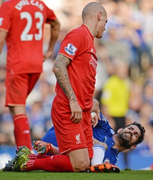 Chelsea's Diego Costa clashes with Liverpool's Martin Skrtel.