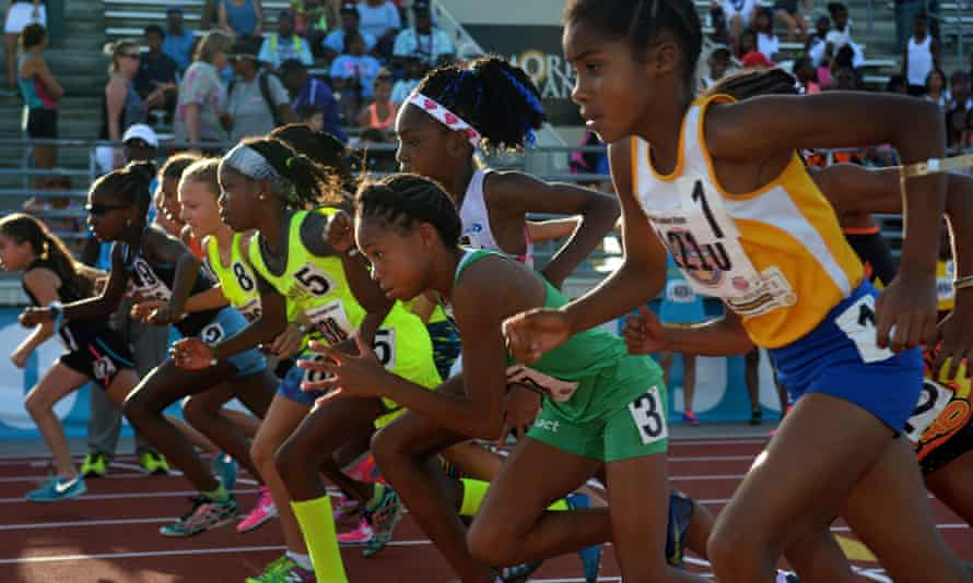 Rainn Sheppard, top center, leaves the starting line with her competitors in the Girls 3000 Meter Run at the 2016 AAU Junior Olympic Games at Turner Stadium in Humble, Texas on Monday.