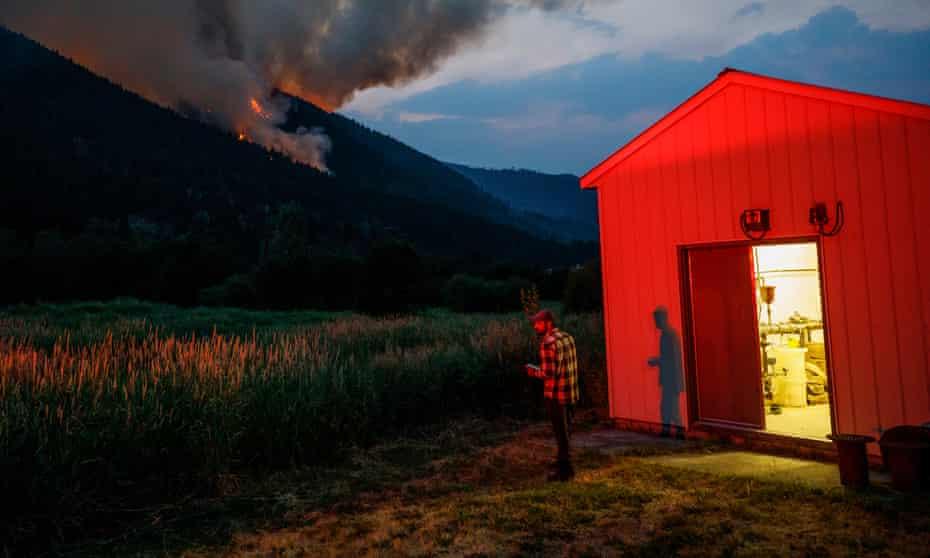 Smoke from the Embleton Mountain wildfire spreads toward the village of Whitecroft, British Columbia.