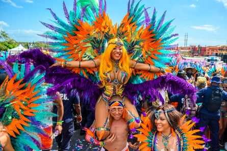 Masqueraders from TRIBE at Trinidad and Tobago's 2020 carnival, with costumes by Solange Govia.
