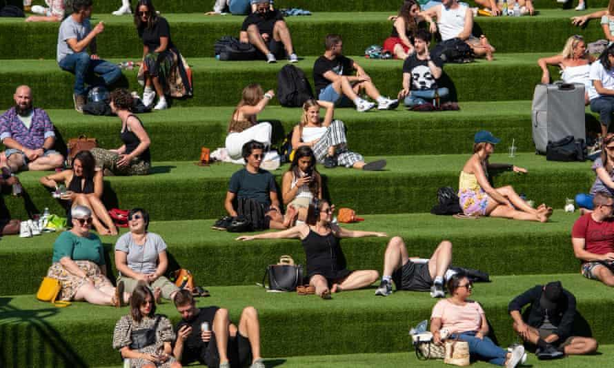 People enjoying the autumn sunshine in Kings Cross, London.