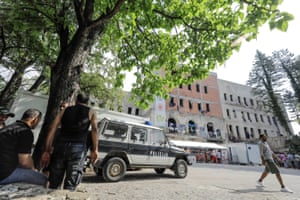 Police vehicle is seen outside war damaged building used as a accommodation and of migrant food canteen in Bihać, Bosnia-Herzegovina