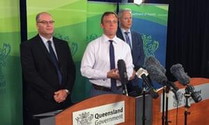 Queensland environment minister, Steven Miles, centre