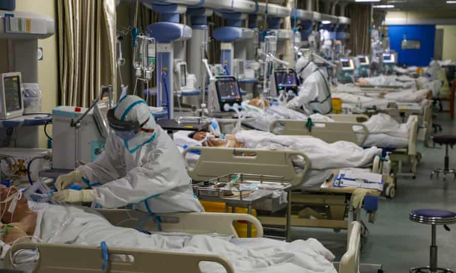 Medical staff work in the isolated intensive care unit in a hospital in Wuhan.