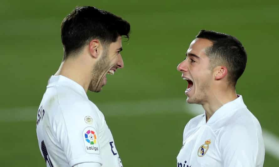 Marco Asensio of Real Madrid (left) celebrates with his teammate Lucas Vázquez after making it 2-0 against Celta Vigo.