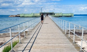 A wooden pier connects Ribersborg beach in Malmö with the Ribersborgs Kallbadhus open-air swimming bath.