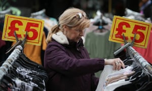 A shopper browses for clothes at a stall at Whitechapel market in east London
