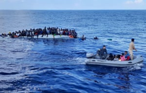 Migrants on a rubber dinghy during a rescue operation off the coast of Libya in the Mediterranean Sea.