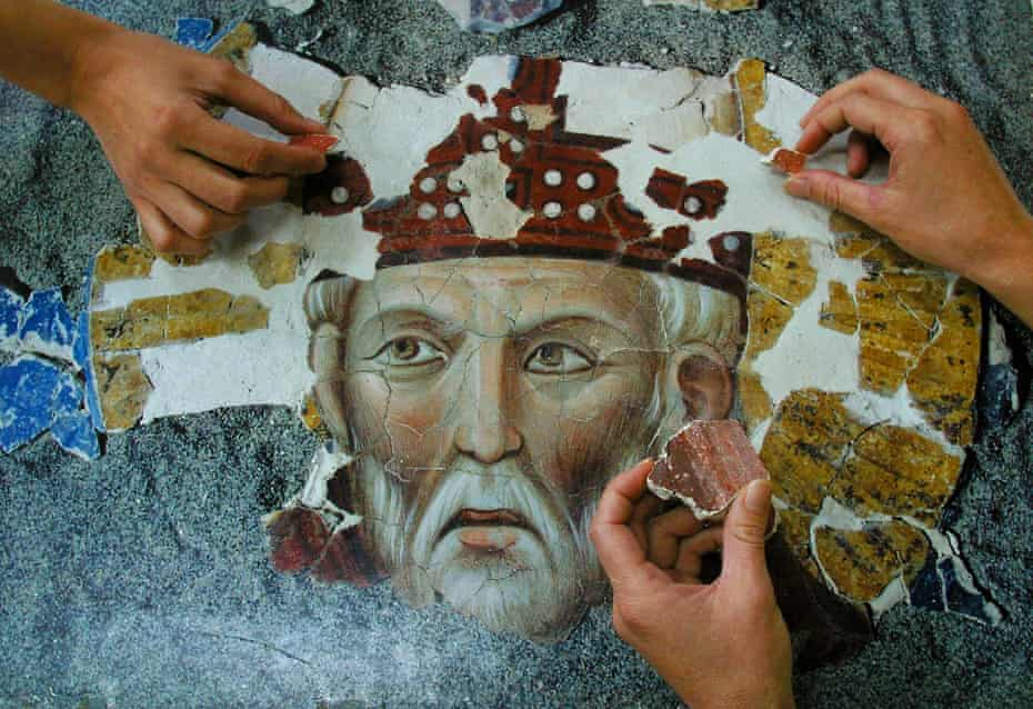 Restorers work on Giotto's 13th-century fresco of Saint Rufus, in Assisi, Italy.
