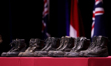 Boots representing the three RFS firefighters who died in the NSW bushfires and the three Americans who died in a water-bombing tanker crash