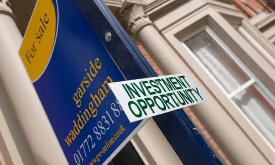 An estate agent's sign in front of a house, with 'investment property' sign attached