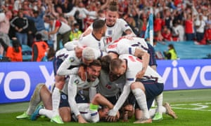 Harry Kane of England (obscured) celebrates with team mates after scoring their side's second goal.