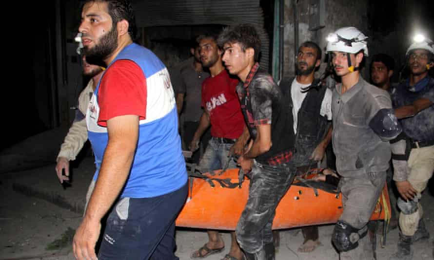 Syrian civil defence personnel carry an injured man following a reported barrel bomb attack in Aleppo. Assad's regime has launched relentless barrel bombing campaigns aimed at making life unbearable for civilians under rebel control