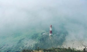 Beachy Head Lighthouse surrounded by mist.