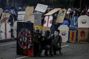 Caracus, Venezuela: Opposition protestors clash with Venezuelan security forces