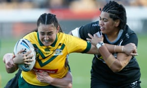 Annette Brander of Australia is tackled by Nita Maynard (left) and Maitua Feterika of New Zealand.