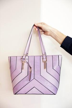 A womens lilac handbag.
