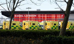 Ambulances lining up outside the new NHS Nightingale field hospital in London