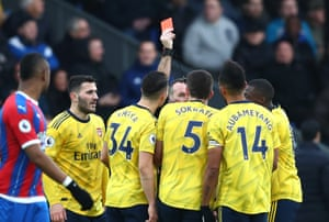 Referee Paul Tierney shows a red card to Pierre-Emerick Aubameyang of Arsenal.