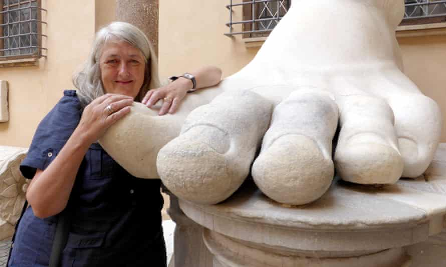 Mary Beard with a statue of the Emperor Constantine in Rome.