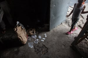 The most widely abused drug is methamphetamine, or tik, as it's easy to manufacture and relatively cheap. Other common drugs on the cape flats are mandrax, marijuana and heroin.A young girl looks on as a large quantity of sealable bags, commonly used to package drugs, is found in a house in Manenberg, Cape Town