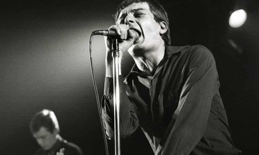 Joy Division, Ian Curtis and Bernard Sumner (L) performing live
