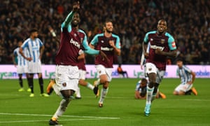 Pedro Obiang celebrates after his strike was deflected in by Huddersfield's Mathias Jorgensen.