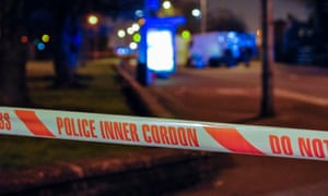 Police tape is stretched around a cordoned off area during a security alert in Northern Ireland
