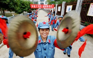 People dressed in Red Army uniforms perform in Yiyang, central Jiangxi province. The slogan reads: 'Celebrate the 19th party congress. Always follow the party.'