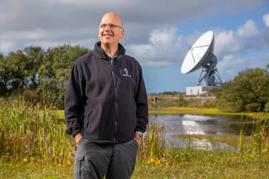 Ian Jones at Goonhilly Earth Station in Cornwall, with the 'Merlin' antenna in the background.