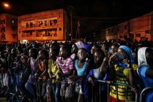 Senegalese young people watch a runway show during Dakar fashion week in the Niari Tali neighbourhood, June 2017