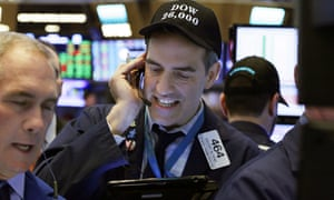 Trader Gregory Rowe wears a Dow 26,000 hat as he works on the stock exchange floor.