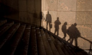 Shadows of anonymous figures and steps at London Bridge.
