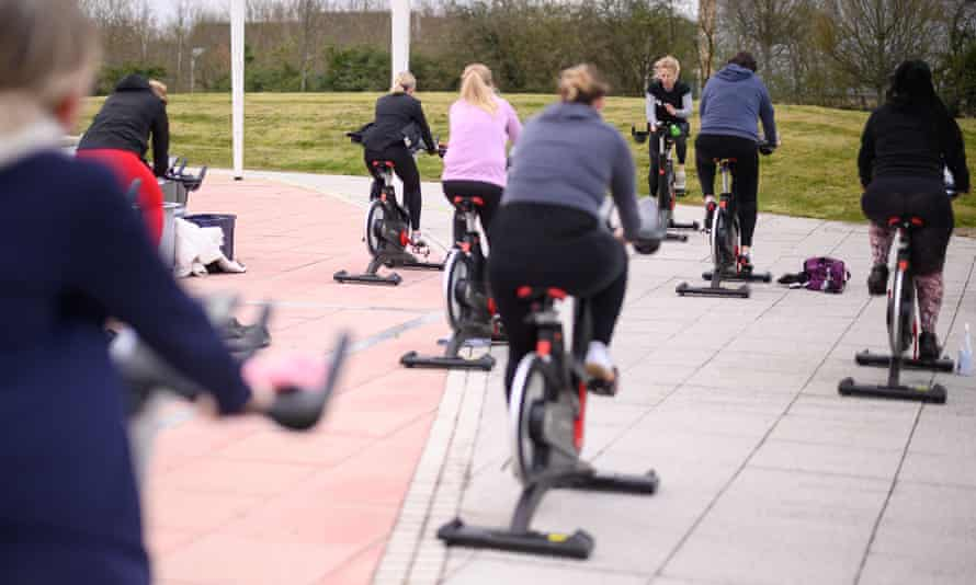 A spin class takes place beside the open-air lido at Hillingdon leisure centre on March 29, the first day rules were relaxed in England.