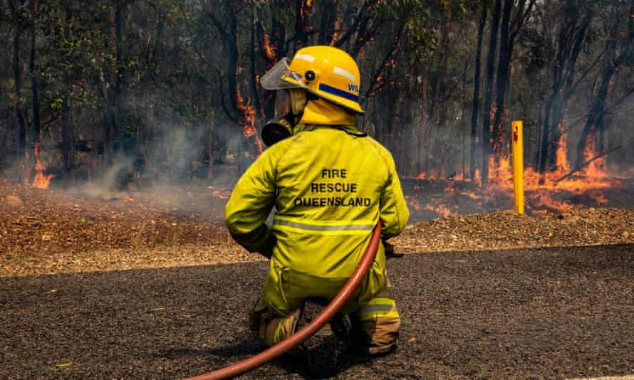 A firefighters working to control a bushfire in Deepwater, central Queensland
