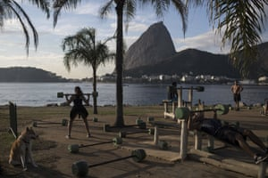 Rio de Janeiro, Brazil People exercise at an outdoor gym on the shores of Guanabara Bay, where Olympic sailing competitions are taking place