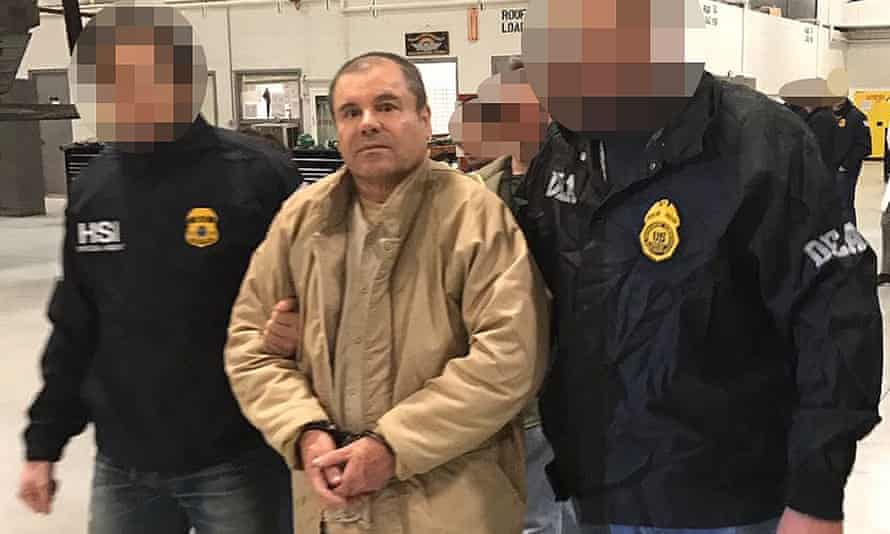 Joaquín 'El Chapo' Guzmán is escorted in Ciudad Juárez by Mexican police as he is extradited to the United States in January 2017.