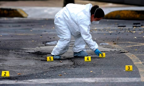 An expert works at a crime scene in Mexico City on 26 June.