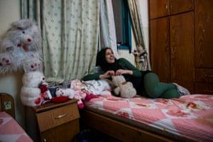 Doaa in a friend's bedroom
