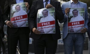 People holding portraits of Jamal Khashoggi rally to support him near the Saudi Arabia consulate in Istanbul.