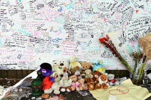 Flowers, missing posters and memorials around Grenfell Tower.