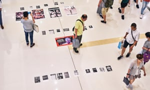 Shoppers look at protest notes inside The New Town Plaza Mall, in Sha Tin.