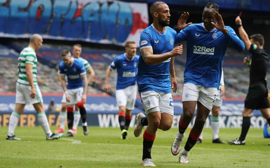 Kemar Roofe celebrates scoring Rangers' first goal with Joe Aribo while in the background Celtic's Callum McGregor is shown a red card by referee Nick Walsh