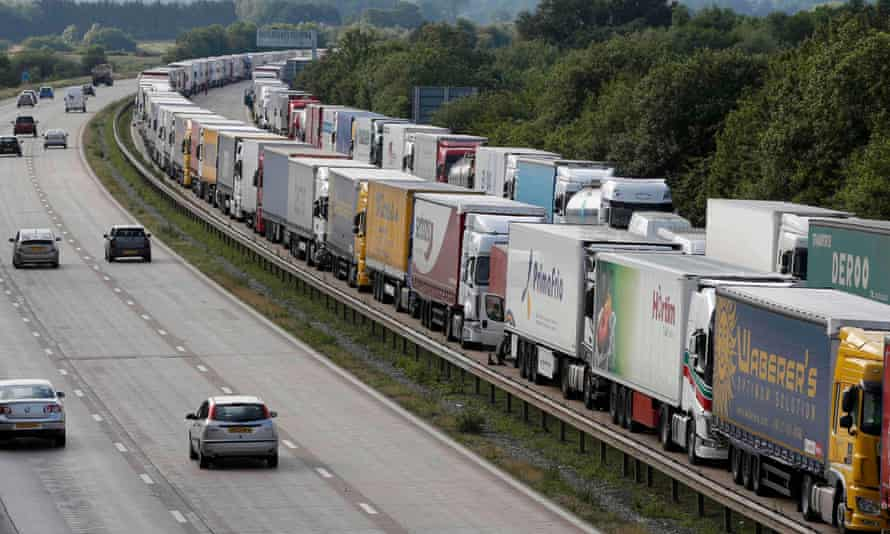 Lorries are backed up on the M20 motorway leading to the Channel tunnel terminal at Ashford.