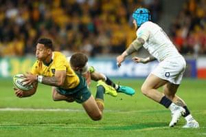 Israel Folau is tackled as Australia put on the pressure.