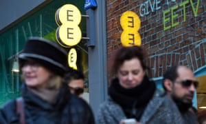 People outside an EE shop