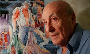 Will Eisner stands next to a poster of The Spirit, the masked comic book hero he created in the 1930.