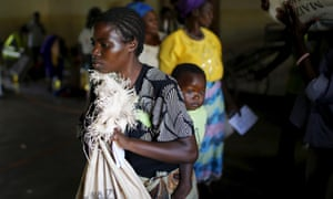 Malawian woman carries food aid